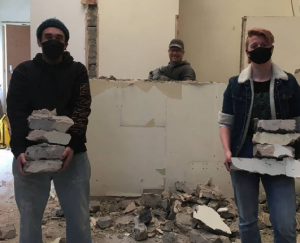 picture of Partisan volunteers hard at work removing rubble